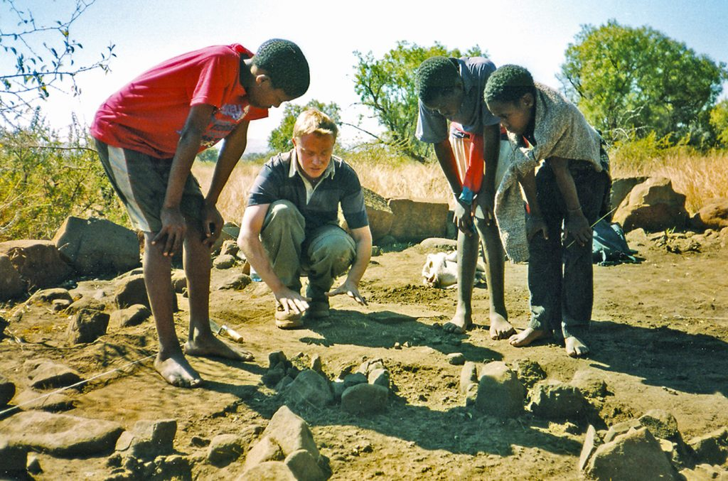 Mark Anderson explains archaeology to African school children