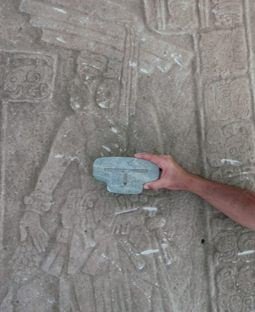 A carved image at the site where the pendant was found pictures a later king wearing it during an incense ceremony