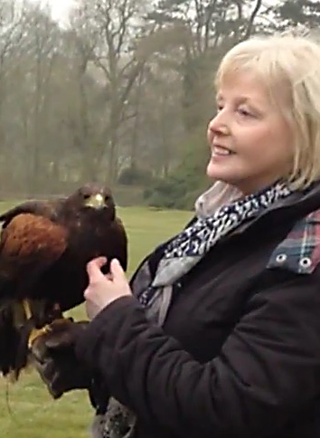 Tutor Jennifer Anderson holding a Harris' Hawk